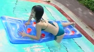 Asian brunette chick Ami Tokito in the pool getting we Preview Image