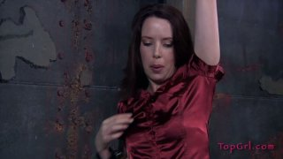Curvaceous MILF in red dress gets punished in the lair of BDSM Preview Image