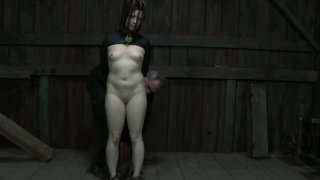 Claire Adams is locked up in a tricky position filming hardcore BDSM video Preview Image