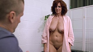 Busty mature with saggy tits seducing a guy Preview Image