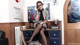 Office solo posing with a vintage-looking MILF Preview Image
