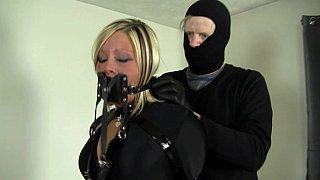 Slave in latex bondage Preview Image