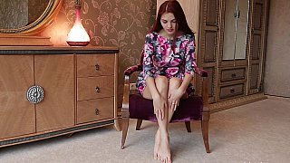 Redhead teen strips naked Preview Image