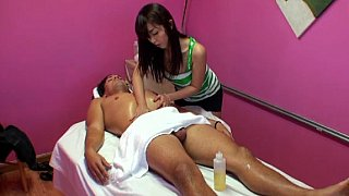 Shy Asian girl is going to rub a client into ecstasy Preview Image