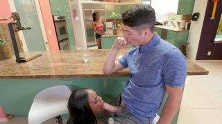 Sarah Banks sucking cock under the counter and her sister is none the wiser Preview Image