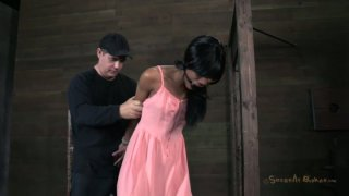 Titless black chick Nikki Darling gets hogtied and has a gag in her mouth Preview Image