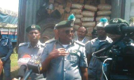 Image result for Customs arrest 100 illegal migrants, impound rice