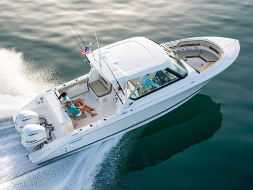 small resolution of the dc 325 dual console combines central utility a starboard side helm center and tremendous seating functionality into an elegantly styled boat