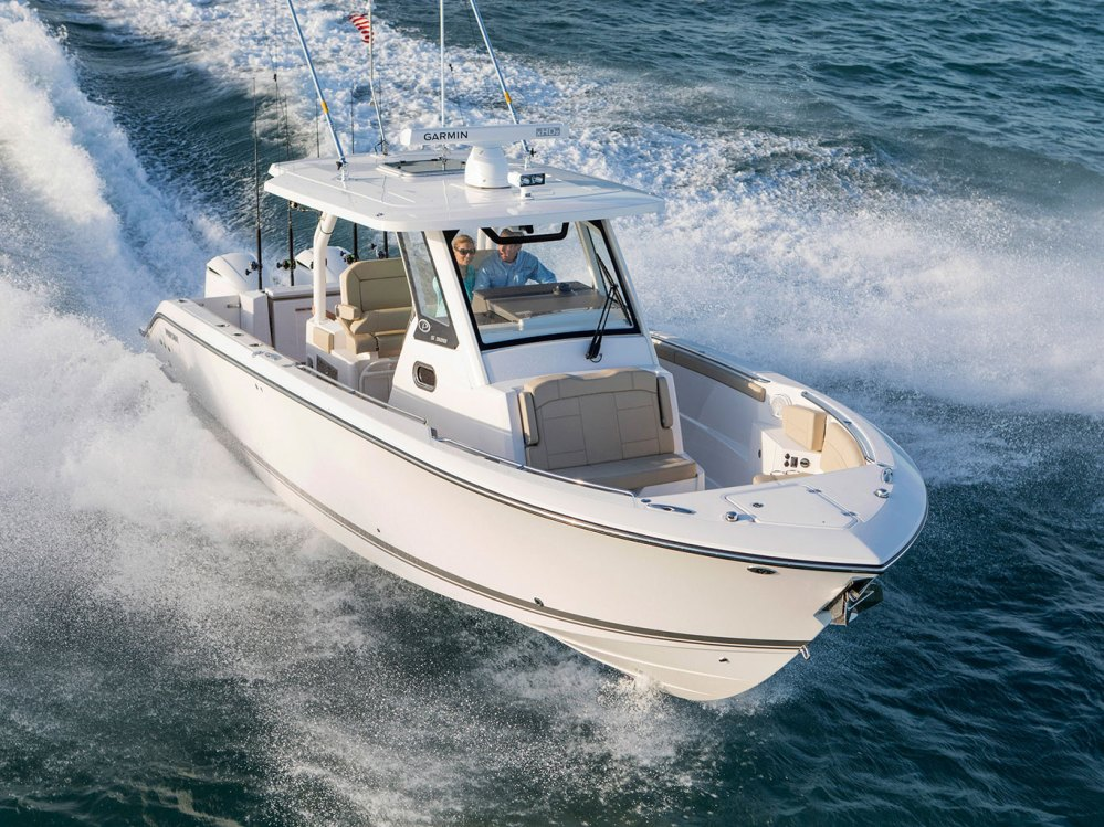 medium resolution of with this 32 luxury center console whether you make a day of fishing diving or cruising you ll do it effortlessly