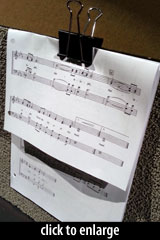 music sheet on stand with clip