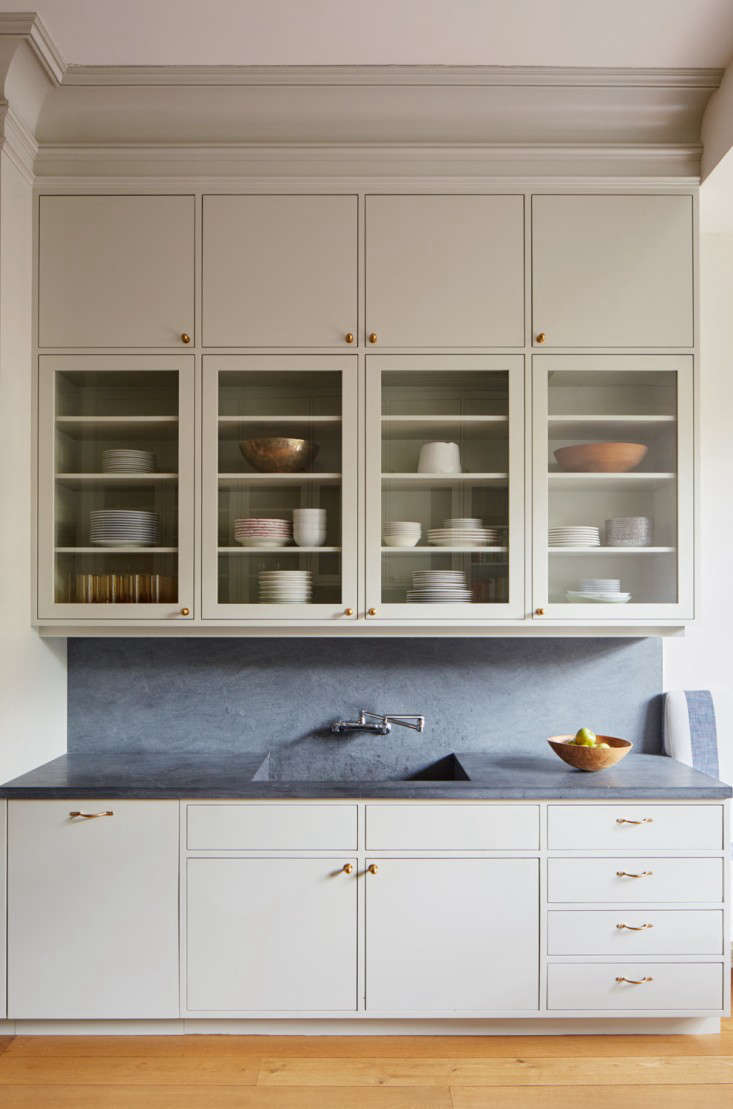 hight resolution of drew lang of lang architecture installed two levels of wall cabinets to take advantage of the