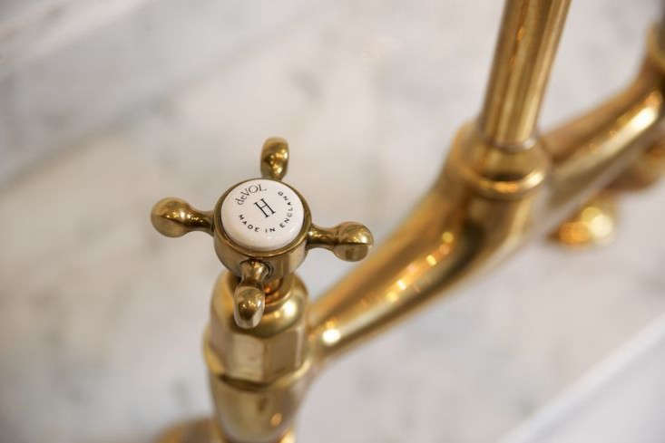 brass faucet kitchen utensil storage found the perfectly aged remodelista above a detail of porcelain tap logo