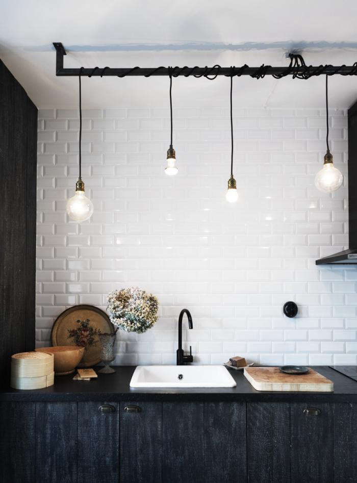 black faucet kitchen countertops quartz high low remodelista above another genius touch a ceiling fixture made from single bulb sockets wrapped around rod commissioned blacksmith and suspended the