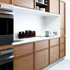 End Kitchen Cabinet Large Mats 15 Storage Ideas To Steal From High Systems Remodelista Garage Door Hinges For Upper Cabinets Allow Easy Access In A By San Francisco