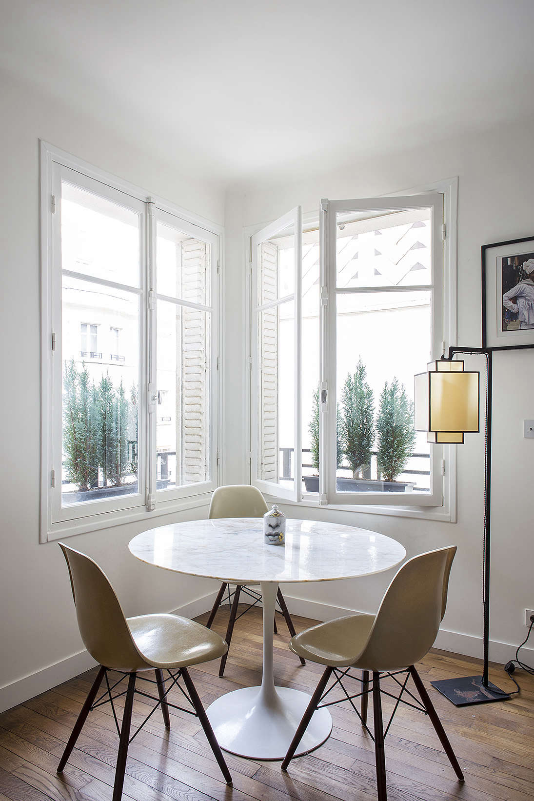 small apartment living room design modern rugs for south africa 9 space ideas to steal from a tiny paris eames side chairs with see through bases that reference the eiffel tower keep corner
