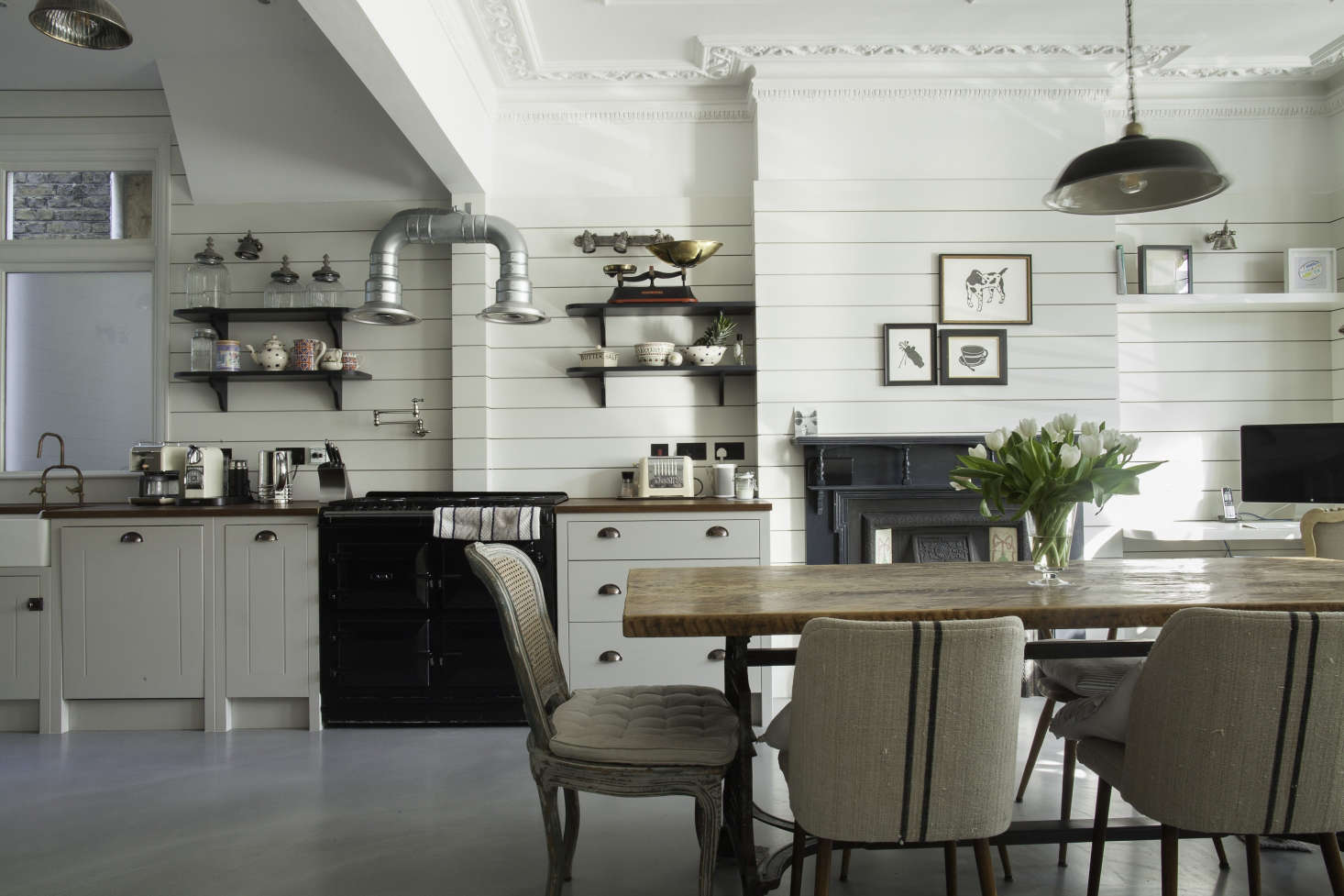 Shiplap wood paneling in a classic English kitchen remodel