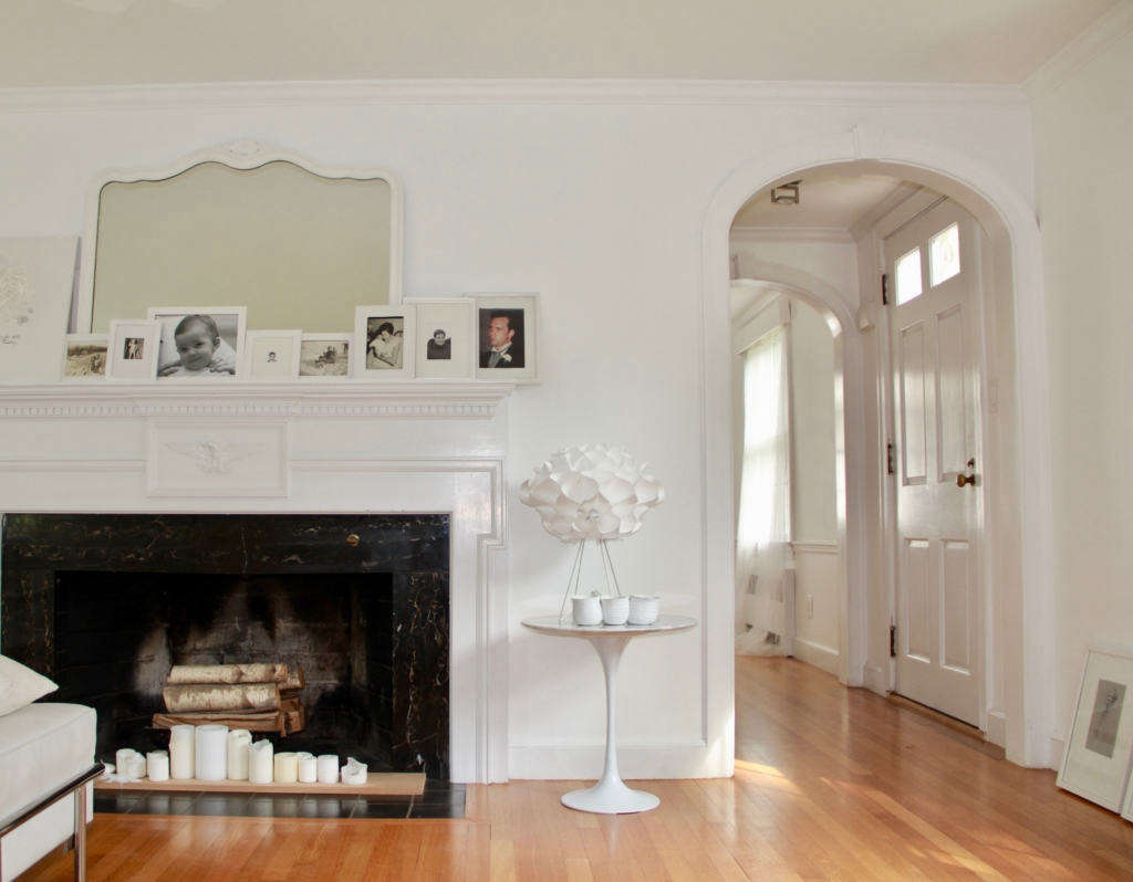 living room boston black and white ideas warm in the suburbs of remodelista arch fireplace with candles main view livingroom