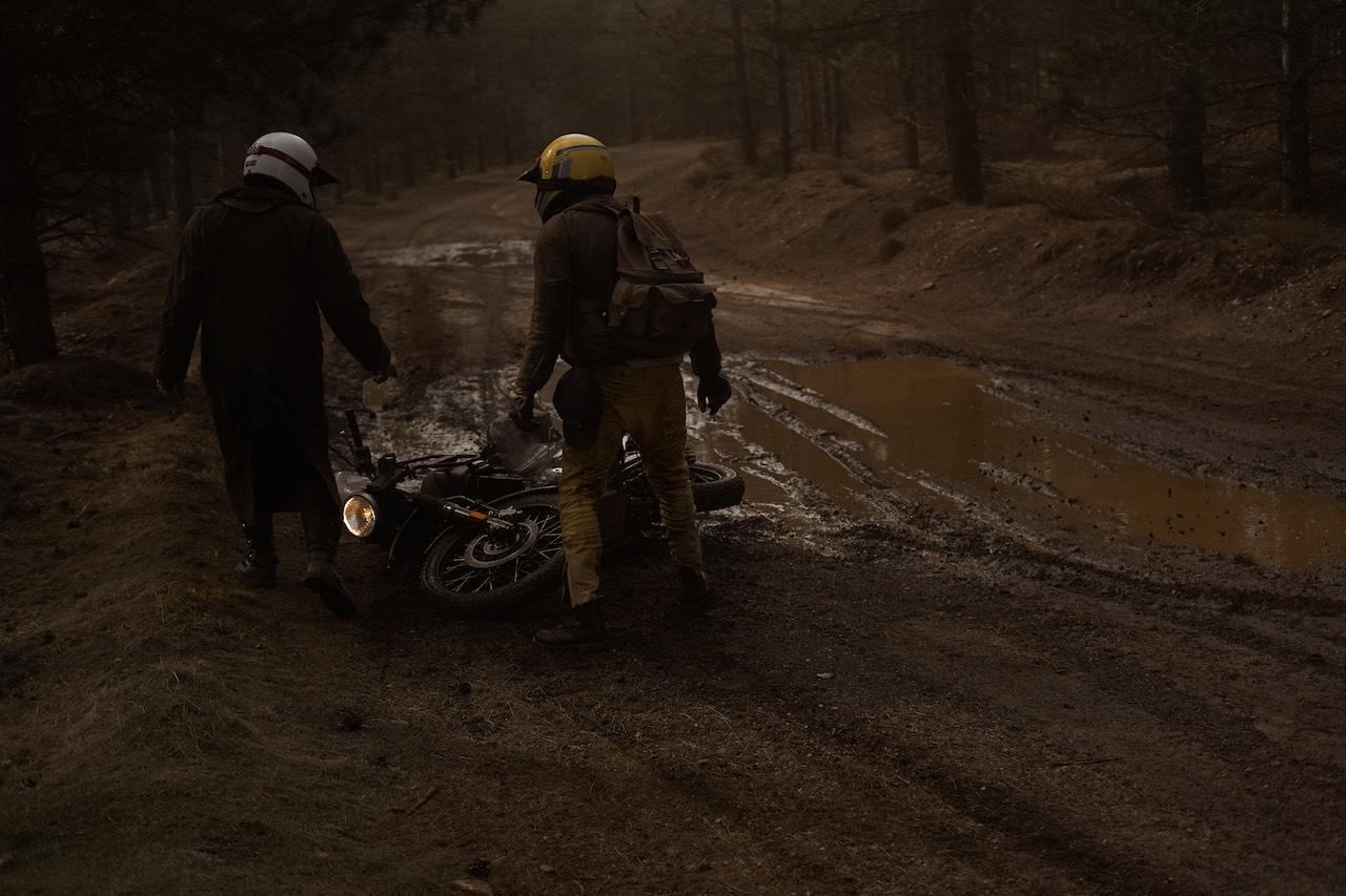 Motorcycle on its side in mud - El Gringo Gus Galvani