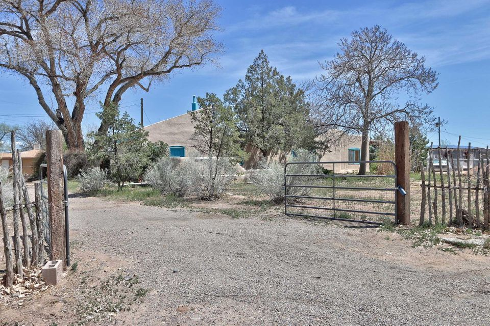 RUSTIC CHARM! Owner financing available! 4 bedroom 2 bath southwest style adobe home with clerestory windows facing south, and vaulted beamed ceilings. Bathroom has an authentic tin wall and claw foot tub. There are painted concrete, tile, and brick floors throughout. The yard has lots of mature trees and a beautiful courtyard for entertaining. This home comes with a 1 year home warranty from AHS. This one is priced to move quickly, you don't want to miss out! Call us today.