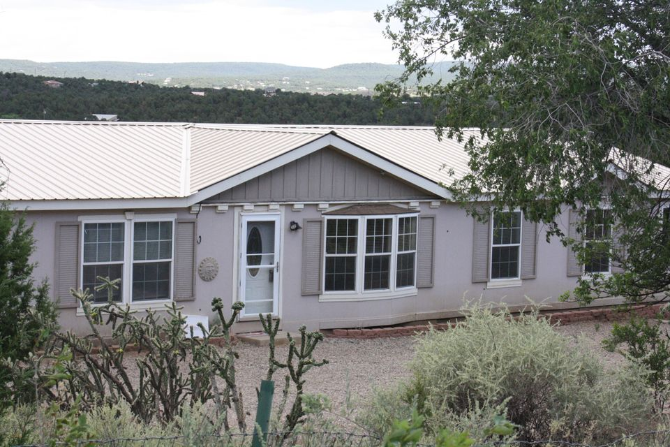 Affordable Horse Property with elbow room!  Enjoy this peaceful country setting just outside of Albuquerque.  Roomy 4 bedroom home with 2 living areas including a cozy pellet stove in the family room, a spacious kitchen and a deck with beautiful views.