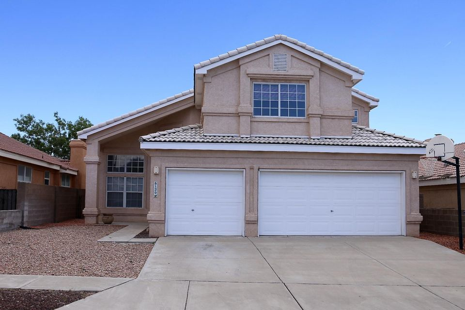 What a great find in Shadow Ridge! This spacious 2750 sqft. home shows 4 Bedrooms, 3 Baths & 3 Car Garage. Enjoy Formal Living & Dining Rooms plus an 18x14 Family Rm w/Fireplace.  Step through the front door and take in the dramatic high ceilings and flood of natural light.  You'll love the Beautiful Oak lam floors and the New plush carpeting! Big kitchen has an abundance of cabinets, countertops and tile flooring plus a cozy breakfast nook w/bay window. The main level Bdrm has french doors making a great office/hobby or guest room with a 3/4 bath nearby. Up the grand staircase shows the 16x15 Master Suite w/Private Balcony & Mountain Views plus a big full featured M. Bath w/large walk-in closet.  Two more BIG bdrms & a second full bath up. A sunroom leads to the back yard. Prime Location!