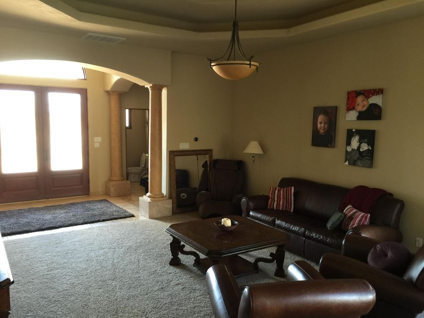 Stunning custom home on 1/3 acre in a private, gated subdivision! This home has all the upgrades you are looking for and is all on one story! The kitchen features Wolf and Sub Zero stainless steel appliances, including double oven, hibachi grill and a pot filler. Upgraded cabinets and granite match throughout the home. The home has a very open floorplan with a lot of light. Includes a separate dining room and parlor, easy to entertain in! Beautiful glass doors welcome your guests and the tall entry way will amaze! The fully landscaped exterior makes it easy to relax and enjoy the outdoors or entertain. Plenty of room to add a pool if you wanted to! The home is at the end of a cul de sac in the gated community and is very quiet and safe! You must see this for yourself!