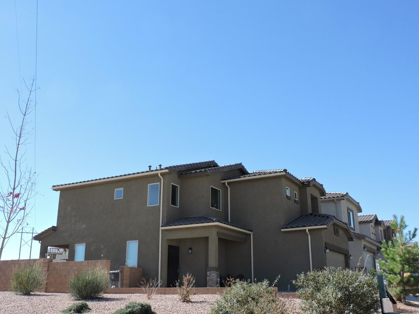 Welcome Home!  Two story, 3 bedroom, 2.5 bath home on a corner lot with GORGEOUS views!   Kitchen has stainless steel appliances, breakfast bar and a pantry.  Ceiling fans in all rooms!  Laundry Room (7' x 7') upstairs!  Tankless Water Heater!  Spanish Tile Roof!  Fully Landscaped front and back with patio to enjoy the outdoors! No backyard neighbor or neighbor to the east.  Property to the east is landscaped lot.  City Park across the street!  Easy Access to I-40.  Offer Now!