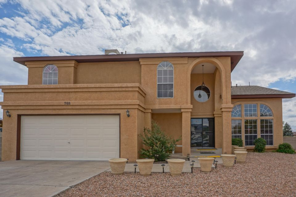 A LOT of LOVE has been put into this house!! Lots of updates since 2011, just to name a few  great tile in the down stairs living area, kitchen counter tops, renovation of the master guest bathrooms, fresh interior paint in the house. Also renovated the deck, downstairs patio ceiling painted and restrained, stuccos been touched up on the house, as well as the Perkalue painted. New window screens, new concrete in the backyard, water heater was relplaced in 2012 and the garage was just painted and textured this year as well as closets upgraded with great shelving.  High vaulted ceiling let in a lot of natural light. Beautiful backyard great for entertaining with backyard access and room to park an RV. Great huge balcony overlooking the amazing backyard. DON'T MISS OUT!! A MUST SEE!!