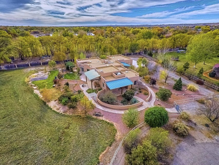 Spectacular 1AC Corrales Gem offers it all!VIEWS TOO!Custom designed & built by nenowned builder Harriett Westman. Attention to detail & quality amenities coupled w the owners desire for an environment free of formaldehyde & outgasses.Universal design.Casual elegance at its finest.Step inside.Magnificent exposed trusses make the Living room a picture to behold.Adobe accent walls between Living & Family rm. Stunning Chef's Kitchen w Dacor appliances &inviting country style island.Master Ste w awesome view window,FP & luxury BA!2 secondary Br's,2Baths + HIS & HER offices. Meandering walkways, portals & private crtyds create special ambiance.PLUS MLS #903841 East Ac available w property for only $769000.00. It's laser leveled & irrigated from underground pipe. Awesome!Amenity list uploaded