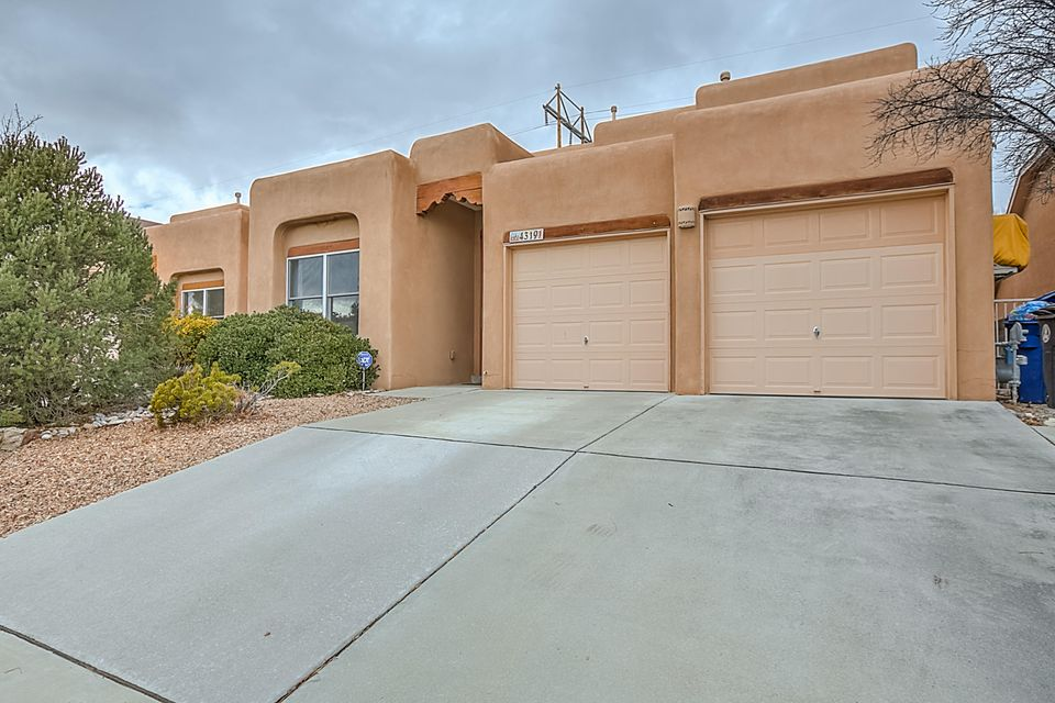 Incredible UPDATED Home. Updated Kitchen w/ GE Appliances, Maple Cabs, Granite Countertops, Custom Tile Backsplash, & Walk In Pantry, Other Custom Features include Tiled Arches, and Nichos , Hardwood & Custom Tile Flooring, Updated Light Fixtures, Ceiling Fans, Solid Wood Doors & Trim, Wood Blinds, Alum. Clad Pella Wood Windows, Plaster Gas Log Kiva Fireplace, Updated Half Bath w/ a Custom Tile Wainscot. MASTER BEDROOM ON THE FIRST FLOOR w/ a Luxurious Master Bath w/  His/Hers Granite Vanities, Custom Tile Backsplashes, Maple Cabinets & a Separate Shower, Tub, & Large Walk-In Closet. Enjoy the Summer Evenings in the Fully Landscaped Backyard with a Nice Covered Patio, Custom Water Feature, and Great Views of the Petroglyphs. Backs up to the Walking/Biking Trail. MOVE IN READY!