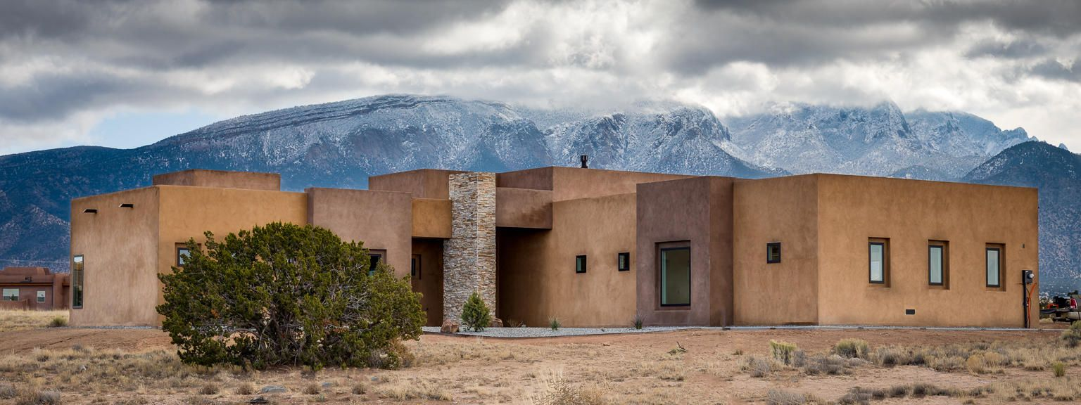 Beautiful New Custom Built Modern Pueblo Style Home. Incredible views of the Sandia Mountains and Santa Ana Mesas.  This new beautiful custom home is situated on a fully foliated native lot with panoramic views. This Modern New Mexico Pueblo Style Home was built with all the high end custom features including custom, hand crafted cabinets throughout home. Large beams & tall ceilings with an open floor plan.  Kitchen has a large butler's pantry.  Interior walls are soundproofed in the family room and master bedroom. Incredible large windows taking advantage of Mountain views. Outdoor kitchen area with large covered outdoor patios.  Back Porch is cantilevered to accommodate un-obscured views.Large 3 car garage fully insulated.AMust see one of a kind custom home.