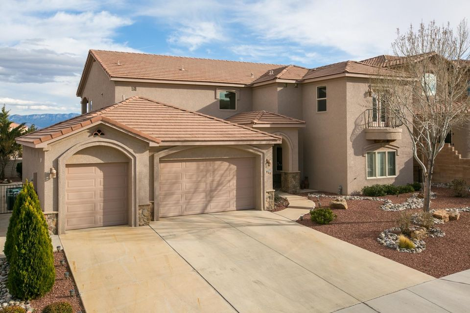 EXCEPTIONAL Dream Home w/views of the Sandias and City Lights from huge covered balcony and patio! Backs to Open Space. Resort-Like living in this Custom Beauty with all the finishes!High end counter-tops thru out home, gourmet kitchen w/ built-in fridge, double oven, gas cook-top. Huge master bedroom with ensuite - jetted tub, walk in snail shower, his and her vanities, large walk-in closets with separate owners laundry, adjacent sitting room/hideaway room. 3 separate downstairs bedrooms with large living area and walkout access to covered patio and low maintenance backyard landscaping. Main Living area is the upper level with views galore from a home built to accent views and natural lighting accessible by a elevator. Quality and Economy are beautifully combined in this incredible home.