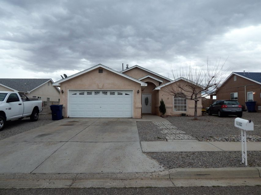 Desirable Los Lunas location! Easy access to I-25 and minutes to Albuquerque. Excellent floor plan, vaulted ceilings, laminate flooring in Great Room, plant ledges, built-ins, computer room, oak cabinets in Kitchen. Garden jetted tub, separate shower and large walk-in closets in Master Bathroom. 2-car attached garage and side yard access for parking.  Convenient to Walmart, schools, shopping, theater, restaurants & everything you need!