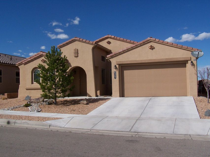 Impeccable 2150 sq.ft. 3 bedroom/3 bath custom home.  Build Green NM Silver level, fully landscaped F/B, Mt views, Chef's Kitchen w/granite & stainless appliances, Double Oven, gas cooktop, 9 ft. ceilings,Tile in all wet areas,wood flooring in main living area & formal dining room, stacked stone fireplace, & large master bedrm, gardentub,separate shower & double sinks. Huge walk-in closet that connects to laundry room. Decorator paint w/newly painted baseboards. Enclosed 200 sq.ft. patio,not heated but not included in sq. ft. Great schools. Backs to open space for privacy. Tandem 3 car garage w/epoxy flooring. views of Sandia Mountains. During ALB Balloon Fiesta picture yourself in the back yard enjoying a cup of coffee and experience balloons landing! Easy access to Paseo Del Norte,