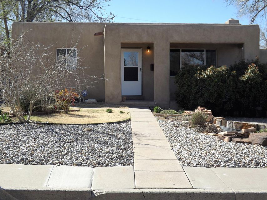 Location!  Minutes from UNM, CNM and Nob Hill located in the highly desired Nob Hill South.  Wonderful floor plan.  When you walk in your welcomed with a beautiful fireplace. This home has three bedrooms with a huge master. The back yard is an entertainers dream.  For a private showing today call today!