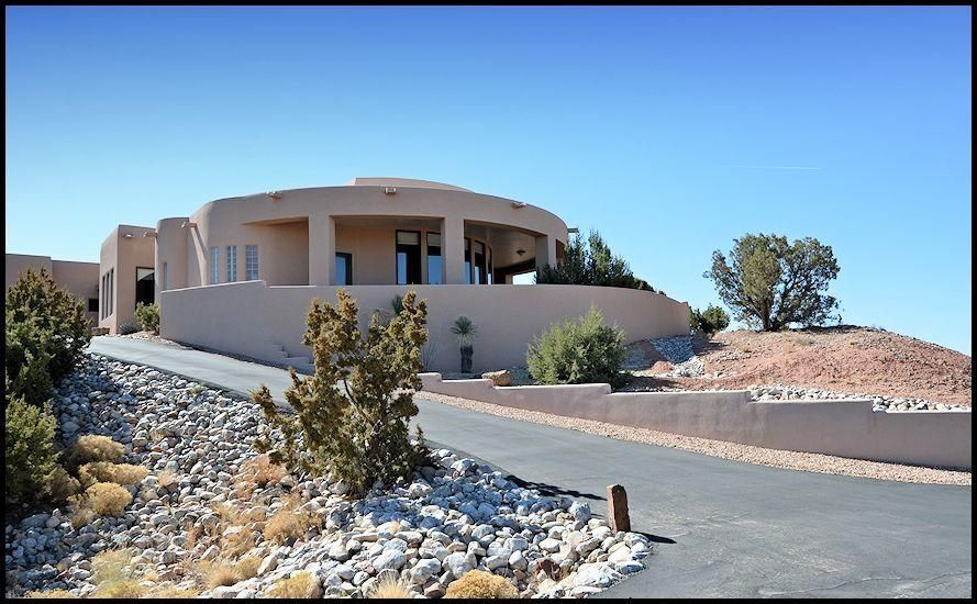 Like-new condition on this Southwest masterpiece perched on a hill with glorious views of the Sandia Mountains and city lights. Terrific open floor plan ideal for entertaining. Great room concept with living room, dining room and kitchen all in one space. Top-of-the-line amenities throughout including cook's kitchen with loads of cabinetry, granite counter tops, 6 burner gas stove, center island and pantry. Private master bedroom and office are split from 2 bedrooms on the other side of the home. Each of the guest bedrooms has its own private bath. The office/study could be used as a 4th bedroom. Surround sound a bonus. Large covered patios add to an entertainer's dream home. All this and an over sized three car garage too.