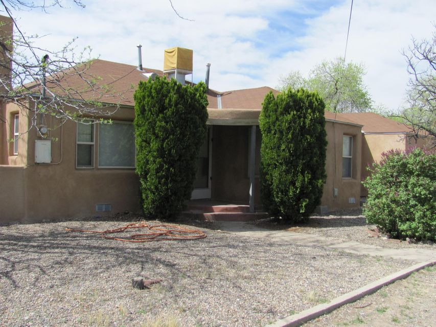 Location, location, location. Three bedroom, one bath.  New stucco, original hardwood floors refinished, new roof.  Walking distance to Rio Grande Nature Center--biking, nature walks along bosque trails. Close to natural foods co-op.