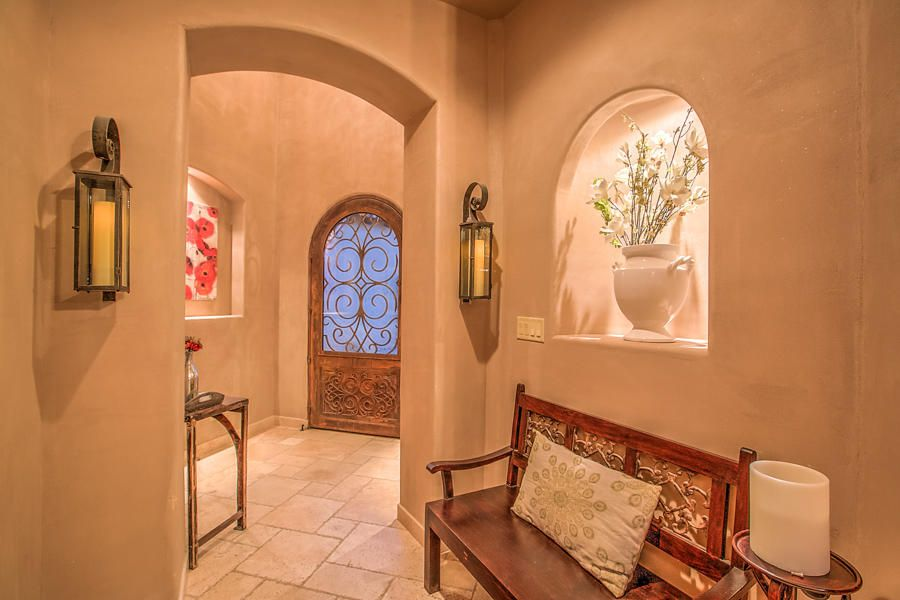 You will love this sensational Tuscan-style home by Picasso.  less than a mile from the best elementary school in the state, best rated overall school district in NM.   plus too many amazing features to count including two master suites, custom cabinets, refrigerated air, and radiant heat. Between monogram stainless steel appliances, a wine cellar, wall-mounted faucets, cantera columns and sinks, plastered walls, granite counters, Alder wood cabinets, and antique railing, no luxury has been missed. Downstairs alone has a sitting area, ceiling fan, walk in shower with dual shower heads, dual sinks with custom mirror, separate water closet, huge walk in closet with built-in shelves and tons of natural light. This home absolutely has it all!