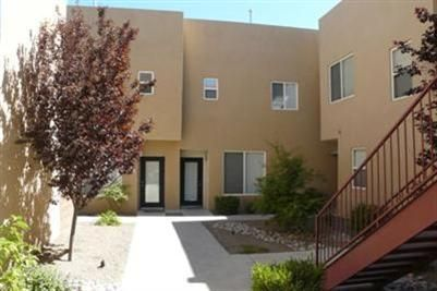 OPEN SATURDAY 1-4 Snazzy, Contemporary Loft Style Condo in A So Convenient Location Near Downtown, UNM and Hospitals**Great Decor and Colors**Secure Courtyard Entry**SW Landscaped Common Area**Quality Appliances, Cabinet, Flooring and Finishes**Wood and Stained Concrete Floors**Roof Access from Master Bedroom for City Views**Light Maple or Birch Cabinets and Doors**Open Metal Railings**Extra Spaces Tucked in Everywhere,Including a Desk Spot in the MBR and a Single Bed Area Recessed Under a Staircase** What a Delight!!Note...Photos are From a Time That Owner Occupied The Property