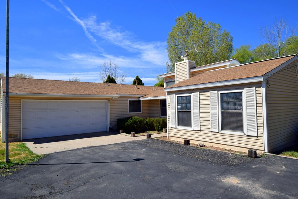 Don't Miss your Opportunity in this Charming 3bd 2ba 2 car garage Ranch Style home that sit's on nearly .65acres. The very well constructed additional 2 car garage offers exceptional space, especially if you're in need of a Work Shop. Along side that the converted horse stalls offer plenty of space for storage. Have an RV want? Well the RV Port and RV Pad will sure be put to great use. With a fabulous wood stove offering plenty of character, the whole house being freshly painted and furnished with blinds is just a Bonus! Did I mention it has REFRIGERATED AIR!!! Come make this quiet House your Home before it's Gone.