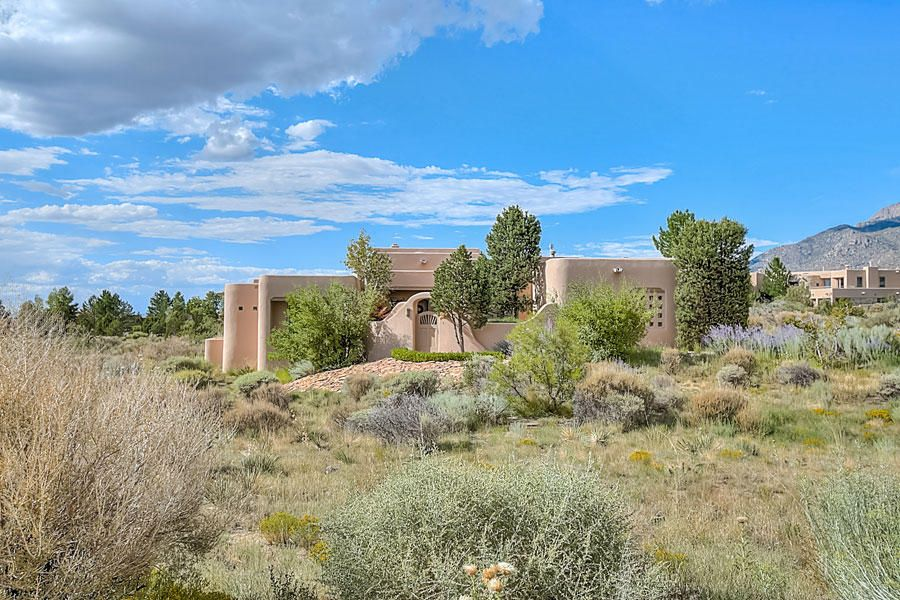Custom One Level *Backs to Open Space*; Foothills/High Desert! One Level Custom by Sun Quality Homes in Distinctive Highlands at High Desert; Pristine & spacious with 4 bedrooms or 3 plus an office study; separate office/study features a private bath custom built-ins & views! Private, separated master retreat with a Kiva style fireplace & outdoor/patio access featuring views of the Sandia's & Open Space! 3 baths; Upscale master bath with a Huge walk-in closet, tub with jets & steam shower, greatroom/entertainment room with a latilla ceiling, custom fireplace & views of the Sandia's, gracious formal dining room, gourmet style kitchen with custom cabinetry, granite counters & stainless appliances; Service room. Radiant in-floor heat, 3 car garage & manicured landscaping. Pristine!