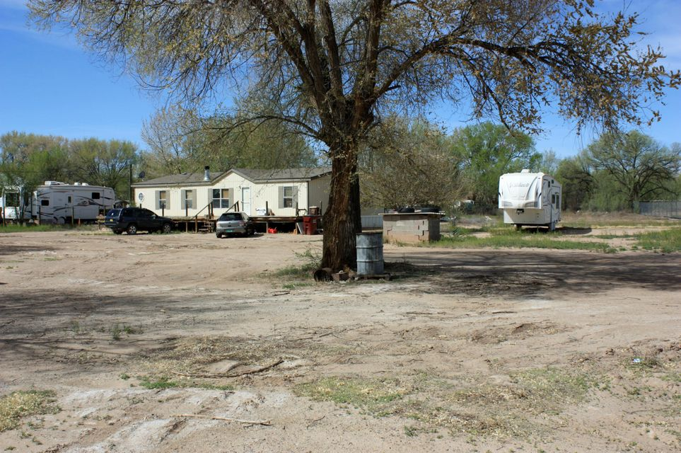 Commercial land with 900 square foot builing for business in front off HWY 47 and Doublewide in back.  Total of 1.6 acres on HWY 47.  Formerly Jake and Andres Restaurant. Great investment to home and work on the same property.