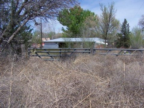 Great opportunity on fixer up Double Wide w/3 car grg. shop on 2.53 fenced acres. SOLD ''AS IS''.No access until about 4/20.