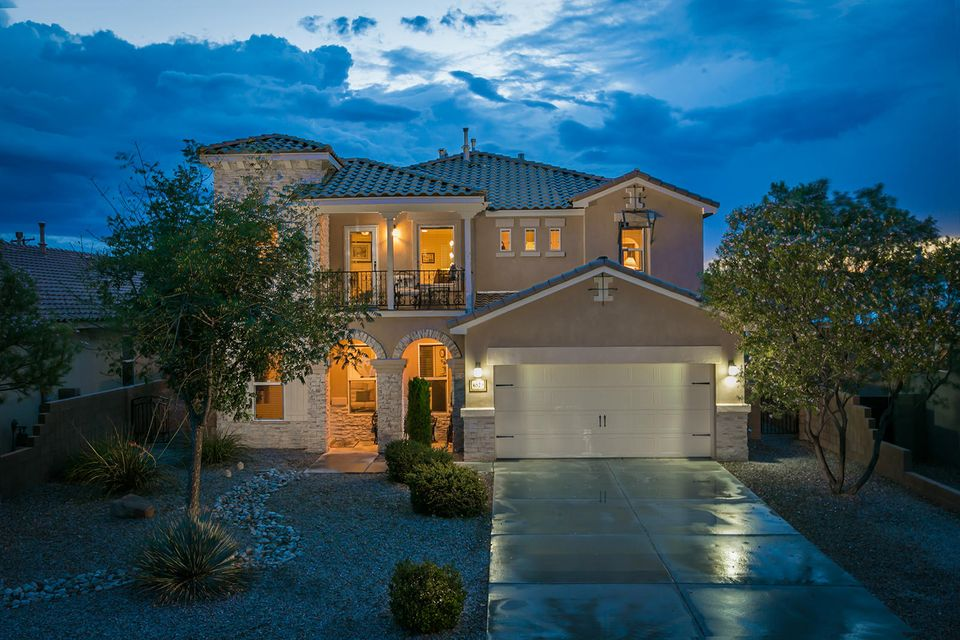 In a charming gated neighborhood just west of Old Town with only 18 lots, sits this one of a kind home with room to spare. This home, a Beazer model, was built to impress, boasting an opulent floor plan with 3 living areas, 5 bedrooms (master conveniently downstairs), a spacious loft, open kitchen and family room, formal dining (currently staged as a sitting area) and a lovely covered patio.  The community boasts a lush common area, landscaping and character. Conveniently located near downtown and I 40 the neighborhood sits on Old Town's bicycle boulevard just a stone's throw to the 17 miles of Paseo del Bosque Trails.