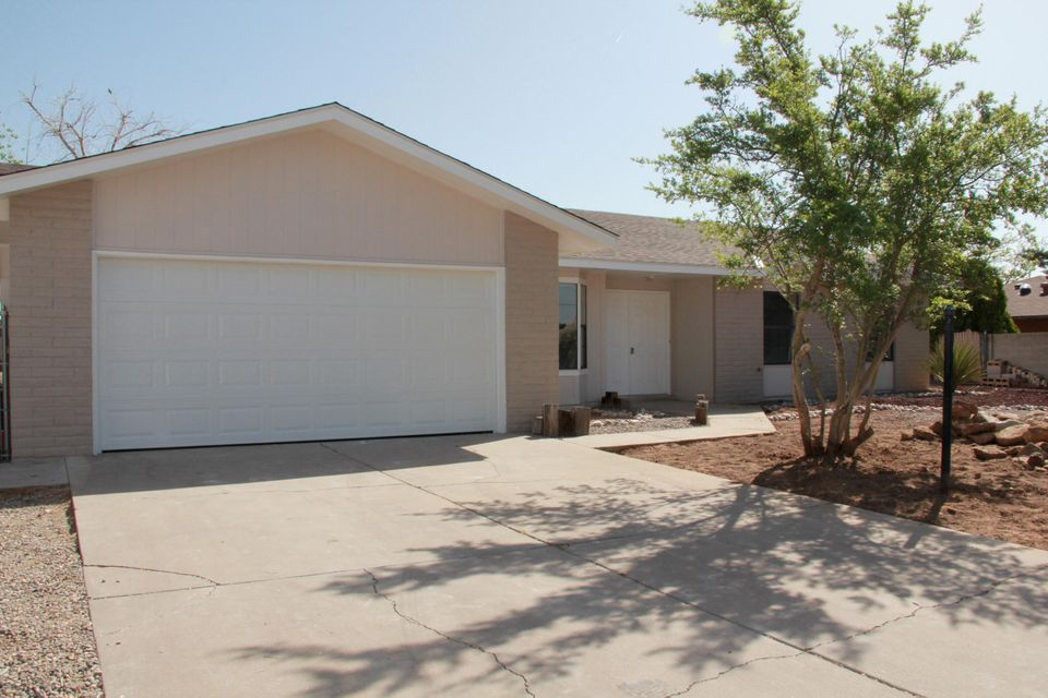 Newly remodeled throughout!! Lovely spacious move-in ready 3 bedroom 2 bath Rio Rancho home!!! Updates include: New laminate wood flooring in all living areas, new carpet in all bedrooms, new tile floors in the kitchen and bathrooms & new paint throughout!! A newly refinished kitchen complete with granite counters, Stainless Steel appliances including refrigerator is open to the great room and dining room.  New Master & guest baths!  The Great room is spacious and inviting with a cozy wood burning fireplace.  A brand new roof and beautiful front yard landscape are just some of the new upgrades! Excellent Open floorpan  has lots character and sits on an oversized lot!