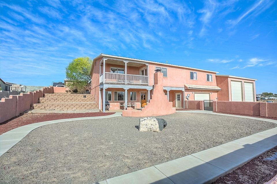 Must see Custom built for family and for the extra toys that we need room for. The roomy kitchen is for cooking up a storm with granite counters, double oven, 5 burner gas cook top, island and eating bar and plenty of custom maple cabinets. Home is wheelchair accessible including all bedrooms and baths. Balcony with Jemez, Sandia and Santa Fe Mt views, city lights. 1 acre lot with back access, detached double garage, storage sheds, and front has a 1260 sq.ft, 2 bay RV garage with plug in and waste drain, an over sized 24x36 garage with workshop and storage. 220  in all garages. Room for all your toys. Front courtyard & covered portal, fireplace to enjoy the evenings outside. Lower level master suite, living space, and separate office. Back has fenced area to keep in the kids and pets