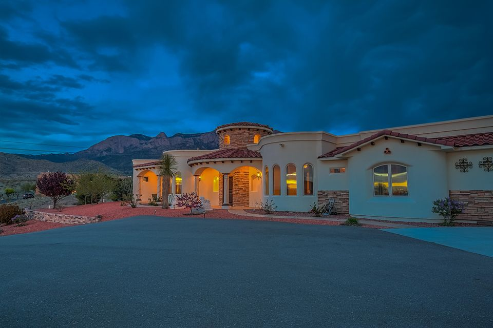 Stunning, Custom Mediterranean style home-Unsurpassable city lights and mountain views-Luxury kitchen complimented with high-end, Viking Appliances-Knotty Alder custom cabinetry, doors and ceilings throughout-Exquisite Granite countertops throughout-Beautiful masters suite with private kitchenette, luxurious bath,  Double walk-in closets-Ten head walk-in shower-unbelievable mountain views- Travertine throughout, radiant heat -Imported stone from Spain. Pella Wood Windows-Built-in aquarium. Gorgeous, oversized salt-water pool. Private entrance to pool from master. Separate living space/pool room with private kitchenette and bath. Perfect for in-laws and guests. Perfect for entertaining. Breathtaking views throughout.
