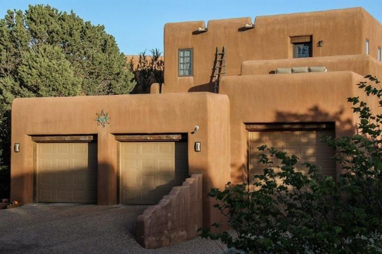 You'll feel like you are sitting on top of the world in this custom designed architectural beauty nestled upon dramatic moss rock outcroppings located in a gated community.  Wood and viga ceilings, brick floors, Hurd windows, balconies and decks. A cliffside hot tub enhances the 360 views of the Sandia Mountains, Tijeras Canyon, South Mountain and the national forest - creating a visual buffet. Inside, you'll find the elegance of a chefs delight kitchen, informal & formal dining, & light & bright family room. Ideal for multi-generational families with community and privacy. Don't miss it!!