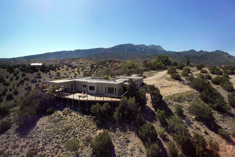Welcome to the privacy and serenity of 3.12 acres in Ranchos de Placitas!  Thorough attention to a complete 2015 renovation has brought modern functionality to this inviting home. Multi-zoned in-floor radiant heating and all hard-surface flooring anchor an interior floor plan that provides separation of the master suite from two more well-sized bedrooms. Both full bathrooms have double sinks and deep soaking tubs. The kitchen offers numerous amenities any home chef would appreciate, including a reverse-osmosis water filtration system and an on-demand hot water beverage tap. Breathtaking views for miles!  Thoughtfully built outdoor areas add over 1600 sf of living and entertaining space!  Nichos, tongue-n-groove ceilings and a designer color scheme make this beauty truly move-in-ready!!