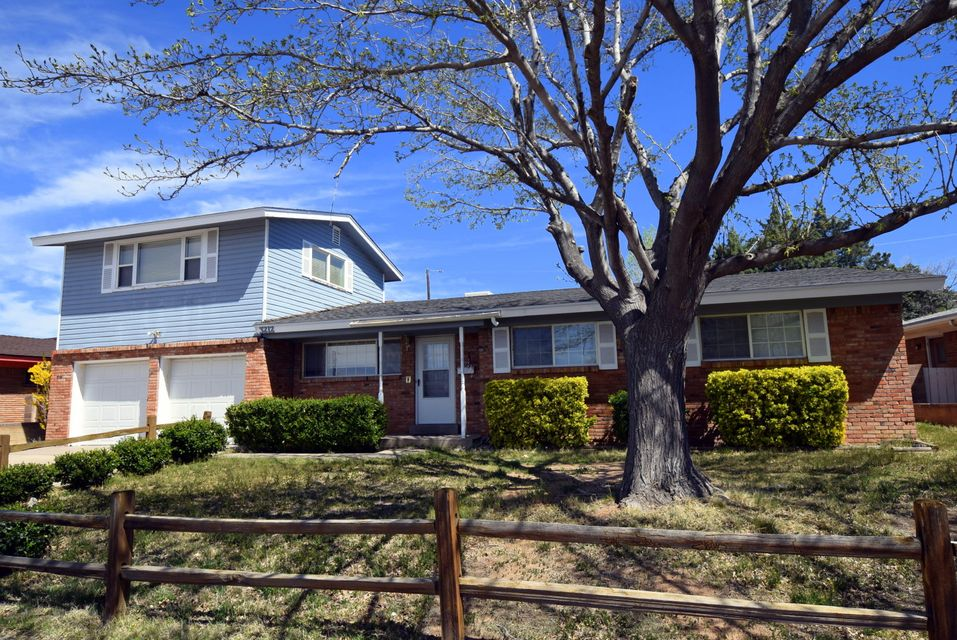 Lots of space in great area! Two master bedrooms-original down and newer master up stairs. Kitchen opens to the living area and dining area. Cozy dining area offer a custom, brick fireplace. Newer windows, newer furnace and roff was redone at the beginning of this year. Building in the backyard (approx 380 sq ft) could be used for a workshop/hobby room.   Come check it out!